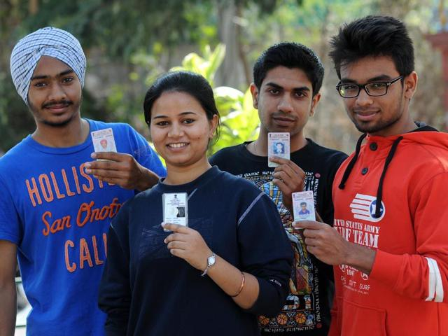 Young-voters-showing-their-voter-cards-after-casting-their-votes-at-a-polling-booth-in-Phase-4-in-SAS-Nagar-on-Sunday-Gurminder-Singh-HT