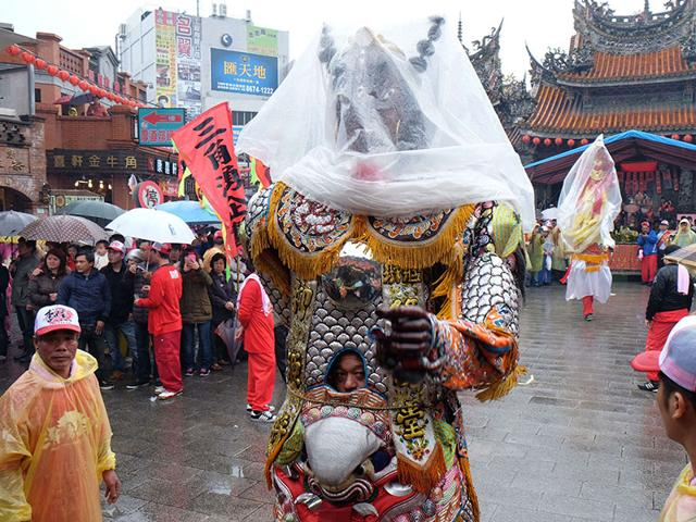 A-man-dressed-in-a-Taoist-god-costume-attends-the-annual-Holy-Pigs-Festival-outside-the-Zushi-Temple-in-Shanhsia-district-in-the-New-Taipei-City-on-Tuesday-Thousands-are-expected-to-attend-the-controversial-Holy-Pig-festival-which-sees-giant-overfed-pigs-displayed-at-temples-in-a-contest-to-see-which-is-the-biggest-a-custom-deplored-by-animal-rights-campaigners--AFP-PHOTO