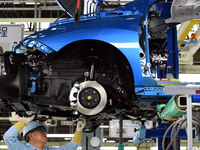 An-employee-of-Toyota-Motors-assembles-FCV-Mirai-on-its-assembly-line-during-the-vehicle-s-line-off-ceremony-at-the-Motomachi-factory-in-Toyota-city-Aichi-prefecture-on-February-24-2015-Photo-AFP