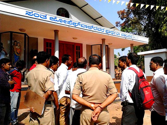 Policemen-inspect-a-church-attacked-in-Mangalore-HT-Photo