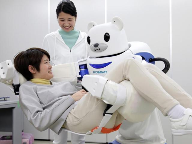 Polar-bear-robot-Robear-lifts-a-woman-for-a-demonstration-in-Nagoya-central-Japan-Photo-AFP