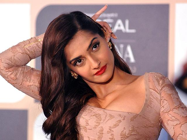 Flashes aimed at me? I don't care, this hairstyle is irritating me already, Sonam Kapoor seems to be thinking. (AFP Photo)