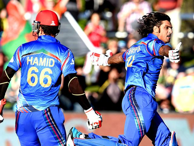 Afghanistan-s-Shapoor-Zadran-celebrates-with-teammate-Hamid-Hassan-after-hitting-the-winning-runs-to-defeat-Scotland-in-their-2015-Cricket-World-Cup-Group-A-match-in-Dunedin-AFP-Photo