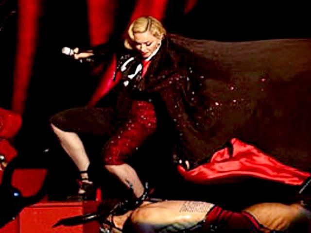 US-pop-star-Madonna-fell-from-the-podium-during-her-performance-at-the-Brit-Awards-YouTube-grab