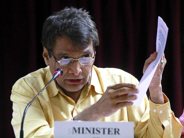 An-Indian-railway-signalman-talks-on-a-radio-at-a-railway-station-in-Secunderabad-the-twin-city-of-Hyderabad-Railways-minister-Suresh-Prabhu-is-scheduled-to-present-the-railway-budget-in-Parliament-AFP-Photo