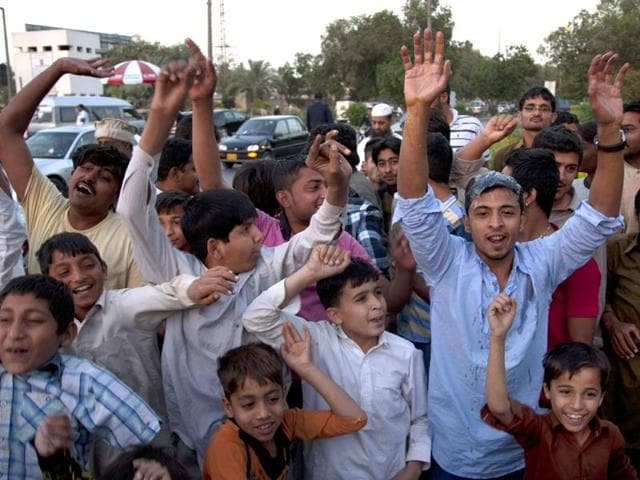 Pakistani-cricket-fans-chant-slogans-to-protest-against-the-country-s-chief-cricket-selector-Moin-Khan-at-Karachi-airport-Thursday-Feb-26-2015-Khan-returned-home-on-the-orders-of-Pakistan-Cricket-Board-chairman-Shaharyar-Khan-for-dining-out-in-a-casino-during-World-Cup-in-Christchurch-New-Zealand-last-week-AP-Photo-Shakil-Adil