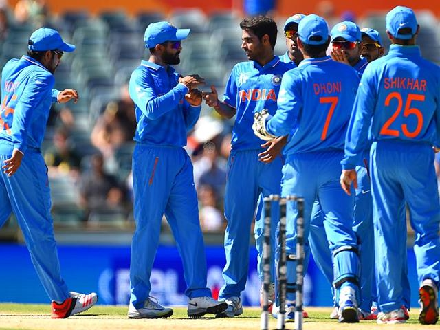 Bhuvneshwar-Kumar-celebrates-with-teammates-after-taking-the-wicket-of-Amjad-Ali-during-the-2015-Cricket-World-Cup-Pool-B-match-between-the-UAE-and-India-in-Perth-AFP-Photo