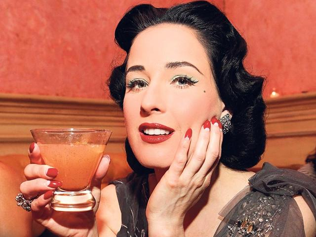 Go-old-school-la-burlesque-diva-Dita-Von-Teese-by-styling-a-reverse-French-manicure-in-a-bold-hue-on-stiletto-pointed-nails