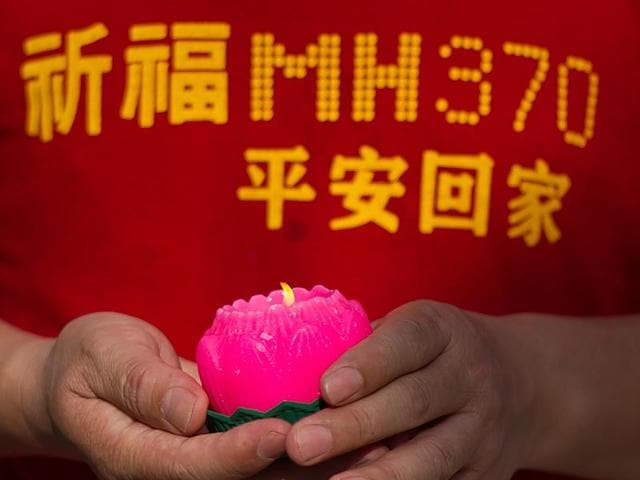 Relatives-of-Chinese-passengers-from-the-missing-Malaysia-Airlines-flight-MH370-are-pictured-during-a-visit-to-Thean-Hou-Temple-to-offer-prayers-in-Kuala-Lumpur-on-March-1-2015-The-visit-to-the-temple-comes-nearly-a-year-after-Malaysian-Airlines-MH370-went-missing-en-route-from-Kuala-Lumpur-to-Beijing-with-239-people-on-board-in-March-2014-AFP-Photo