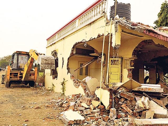 The-IMC-team-demolishes-an-illegal-structure-at-City-Park-Annapuran-Road-in-Indore-on-Saturday-Arun-Mondhe-HT-photo