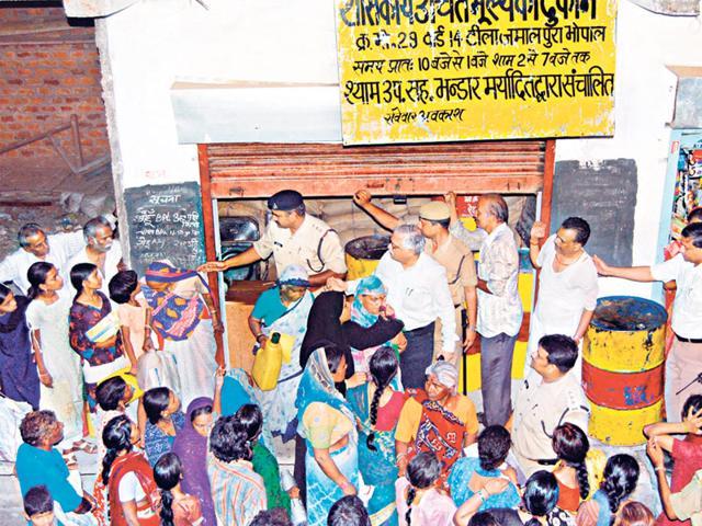 People-wait-outside-a-PDS-shop-in-Bhopal-HT-file-photo