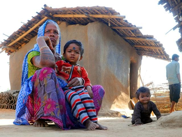 A-2013-report-by-the-UN-Office-on-Drugs-and-Crime-identified-Jharkhand-as-one-of-the-states-most-vulnerable-for-trafficking-of-women-and-children-Here-a-woman-sits-outside-her-hut-at-Garja-village-in-Simdega-district-which-is-notorious-for-child-trafficking-cases-Parwaz-Khan-HT-Photo