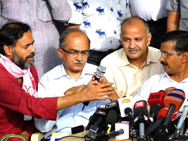 AAP-founding-members-Yadav-and-Prashant-Bhushan-alongside-Delhi-CM-Arvind-Kejriwal-at-a-press-conference-HT-file-photo