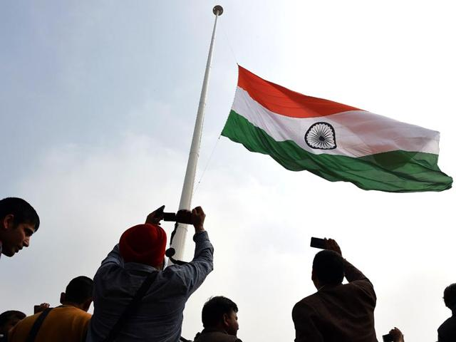 Residents-photograph-India-s-tallest-flag-as-it-is-unveiled-in-Faridabad-to-mark-National-Defence-Day-AFP-photo