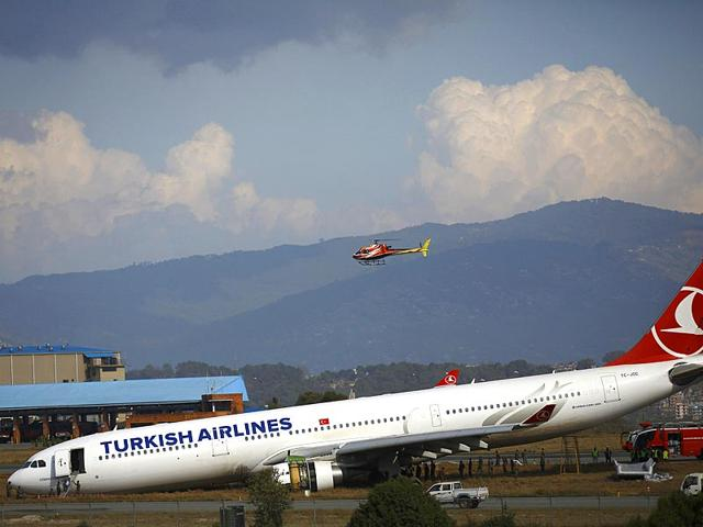 A-Turkish-Airlines-plane-lies-on-a-field-after-it-overshot-the-runway-at-Tribhuvan-International-Airport-in-Kathmandu-According-to-local-media-all-passengers-and-crew-members-were-rescued-Reuters