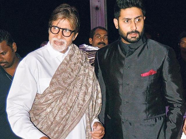 Amitabh-Bachchan-and-Abhishek-Bachchan-arrive-at-the-wedding-reception-of-Tulsi-Kumar-Photo-Yogen-Shah