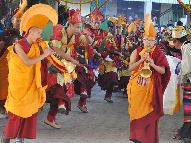 Buddhist-monks-playing-traditional-Tibetan-instruments-during-long-life-prayers-for-Tibetan-spiritual-leader-the-Dalai-Lama-at-Mcleodganj-near-Dharamsala-Shyam-Sharma-HT