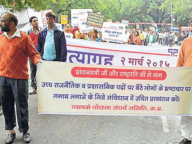 Rashtriya-Swayamsevak-Sangh-supporters-participate-in-a-rally-organised-in-New-Delhi-to-register-their-protest-against-PEB-scam-HT-photo