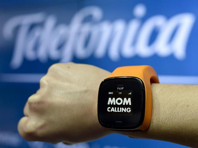 A-hostess-presents-a-watch-FiLIP-by-Telefonica-during-the-2015-Mobile-World-Congress-MWC-in-Barcelona-Photo-AFP