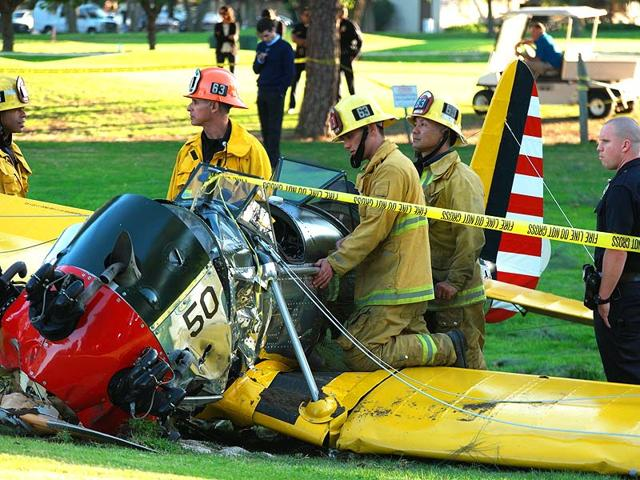 Firefighters-inspect-the-cockpit-of-a-plane-that-crashed-on-a-golf-course-in-Venice-reportedly-piloted-by-US-actor-Harrison-Ford-on-March-5-2015-AFP-Photo