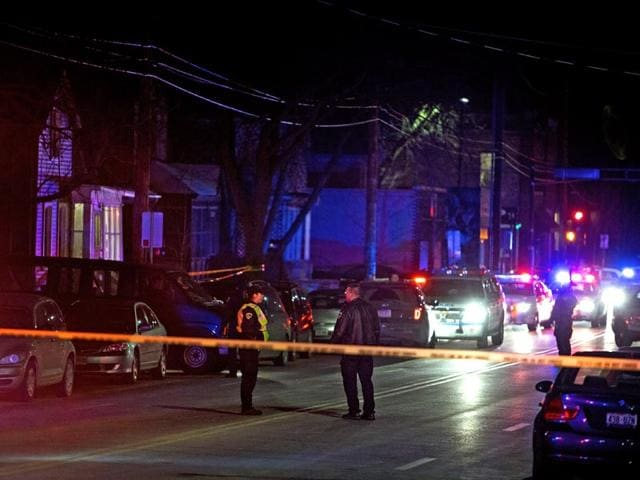 Madison-police-investigate-the-scene-of-a-shooting-in-Madison-Wisconsin-Tony-Robinson-an-unarmed-black-19-year-old-was-fatally-shot-by-Matt-Kenny-a-white-police-officer-AP-Photo