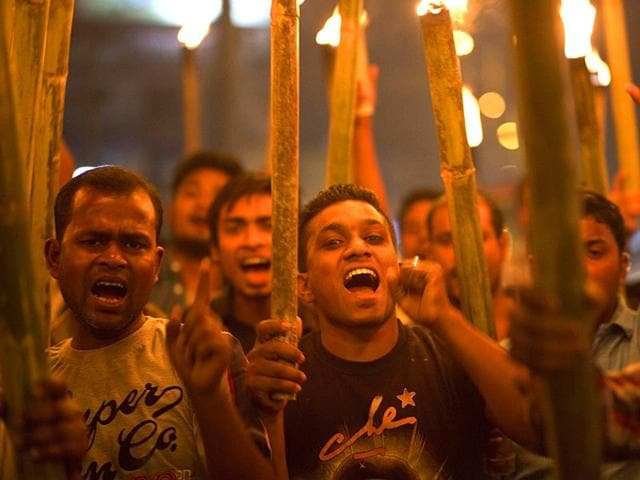 Activists-of-All-Assam-Minorities-Students-Union-shout-slogans-during-a-torch-protest-against-the-lynching-of-a-man-accused-of-rape-AP-Photo