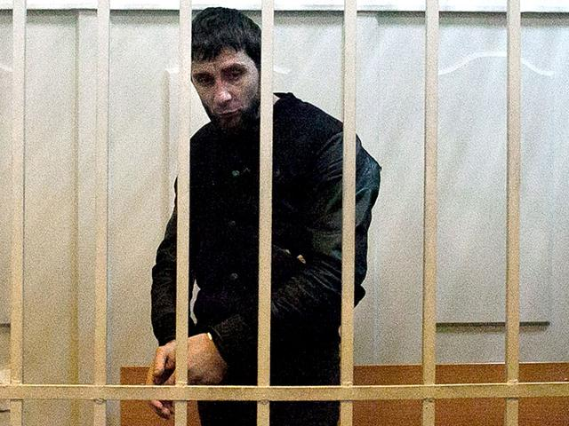 Zaur-Dadayev-charged-with-the-murder-of-Russian-opposition-figure-Boris-Nemtsov-stands-inside-a-defendants-cage-at-the-Basmanny-district-court-in-Moscow-Two-men-of-Chechen-origin-Zaur-Dadayev-and-Anzor-Gubashev-were-charged-with-the-murder-of-Russian-opposition-activist-Boris-Nemtsov-AFP-Photo