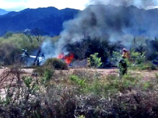 Picture-released-by-NA-showing-the-wreckage-of-a-helicopter-burning-in-flames-after-colliding-mid-air-with-another-chopper-near-Villa-Castelli-in-the-Argentine-province-of-La-Rioja-AFP-PHOTO-NA
