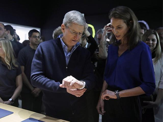 Apple-CEO-Tim-Cook-and-Christy-Turlington-Burns-founder-of-Every-Mother-Counts-look-at-the-new-Apple-Watch-in-the-demo-room-after-an-Apple-event-Photo-AP