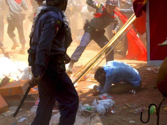 A-police-officer-beats-a-student-protester-in-Letpadan-140-kilometers-90-miles-north-of-Yangon-Myanmar-AP-PTI