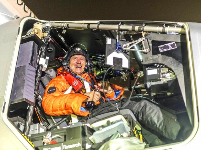 Pilot Andre Boschberg reacts after landing Solar Impulse 2 in Muscat, Oman on Monday. (AP Photo)