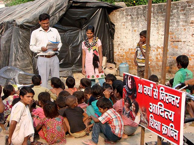 Teacher,slum children,right to education