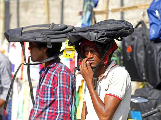 Roadside-vendors-use-school-bags-to-beat-the-heat-on-a-hot-afternoon-in-Mumbai-Pratham-Gokhale-HT-photo