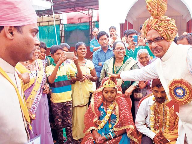 CM-Shivraj-Singh-Chouhan-blesses-a-couple-during-a-mass-wedding-ceremony-organised-in-Hoshangabad-on-Wednesday-HT-photo