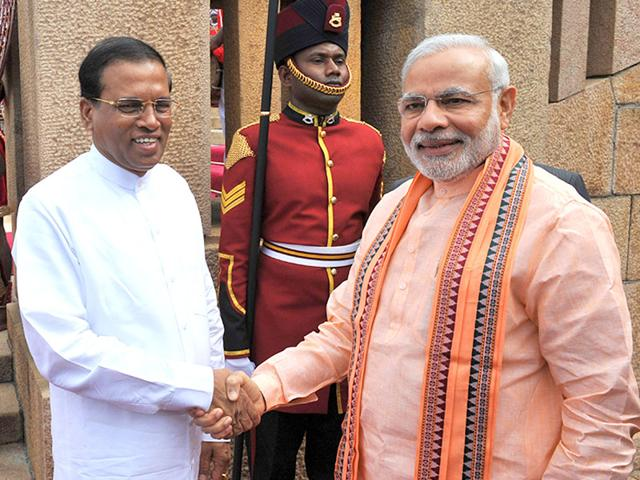 Prime-Minister-Narendra-Modi-shakes-hands-with-Sri-Lanka-President-Maithripala-Sirisena-at-the-ceremonial-reception-in-Colombo-on-March-13-2015-AFP-Photo