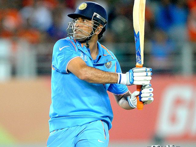 MS-Dhoni-hits-a-shot-in-the-2015-World-Cup-match-between-India-and-Zimbabwe-in-Auckland-AP-Photo