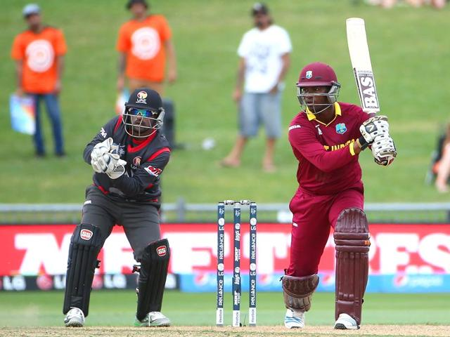 West-Indies-batsman-Johnson-Charles-runs-between-the-wickets-with-United-Arab-Emirates-wicket-keeper-Swapnil-Patil-L-in-ready-during-the-Pool-B-2015-Cricket-World-Cup-match-between-West-Indies-and-United-Arab-Emirates-at-McLean-Park-in-Napier----AFP-Photo-Fiona-Goodall