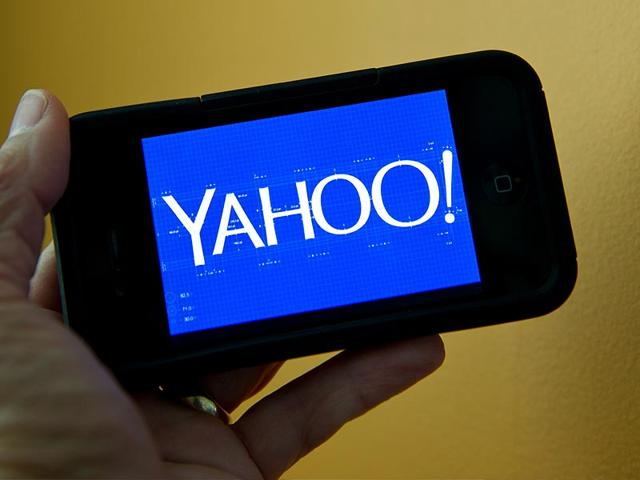A-person-walks-in-front-of-a-Yahoo-sign-at-the-company-s-headquarters-in-Sunnyvale-Calif-Photo-AP