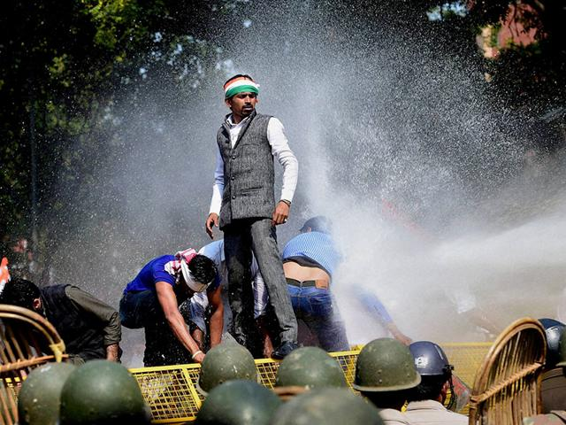Police-use-water-cannons-to-disperse-Youth-Congress-workers-during-a-protest-over-land-acquisition-bill-at-Parliament-Street-in-New-Delhi-PTI-photo