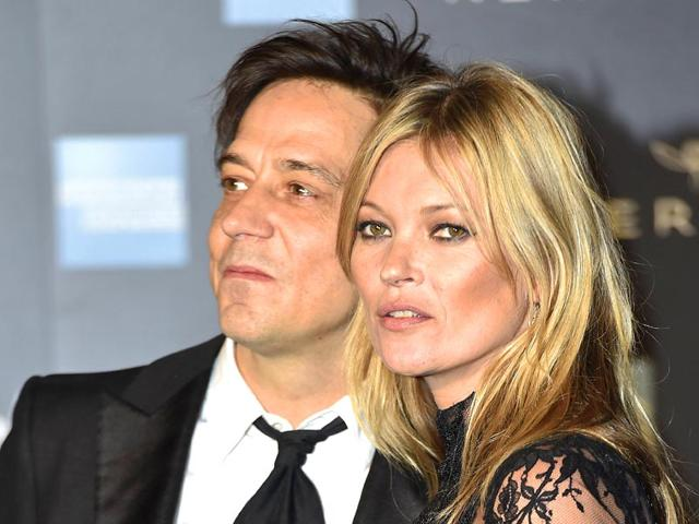 Model-Kate-Moss-and-her-husband-Jamie-Hince-arrive-for-the-Alexander-McQueen-Savage-Beauty-exhibition-gala-at-the-Victoria-amp-Albert-Museum-in-London-Photo-Reuters
