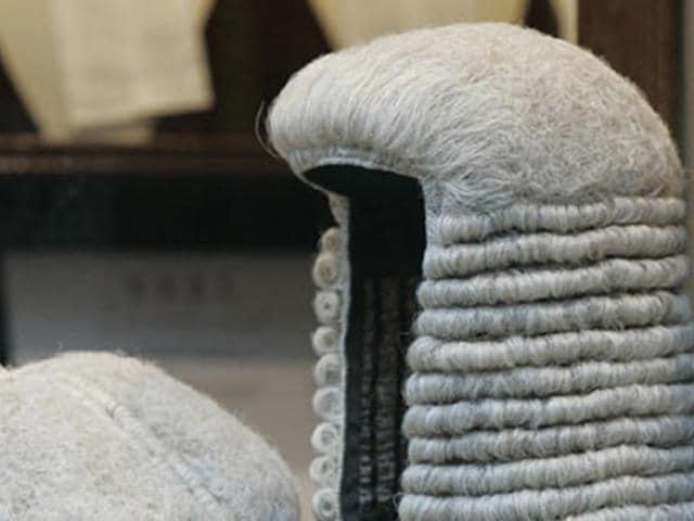 British judges removed,pornographic material,disciplinary inquiry