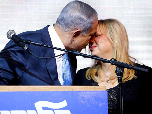 Israeli-Prime-Minister-Benjamin-Netanyahu-kisses-his-wife-Sara-at-party-headquarters-in-Tel-Aviv-Netanyahu-claimed-victory-in-Israel-s-election-after-exit-polls-showed-he-had-erased-his-centre-left-rivals-lead-with-a-hard-rightward-shift-in-which-he-abandoned-a-commitment-to-negotiate-a-Palestinian-state--Reuters