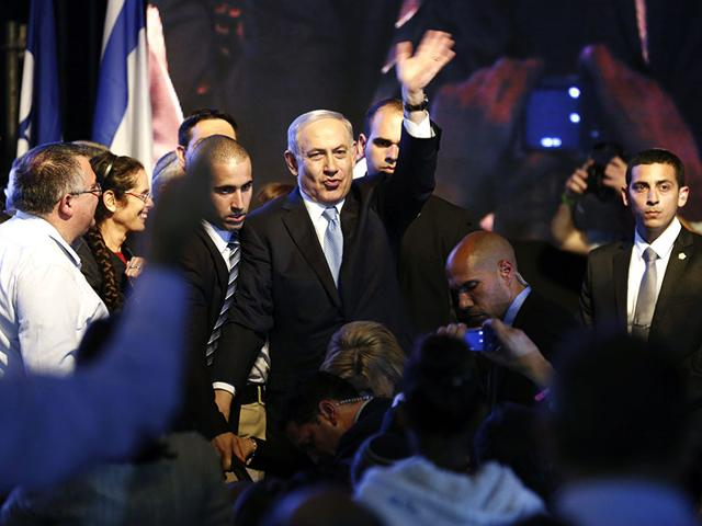 Israeli-Prime-Minister-Benjamin-Netanyahu-waves-to-supporters-at-party-headquarters-in-Tel-Aviv-Reuters-Photo