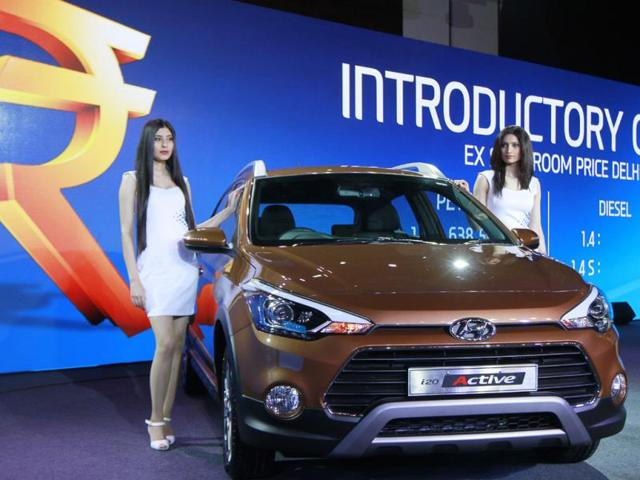 Models-with-New-i20-during-the-launch-of--i20-Active-in-New-Delhi-India-on-Tuesday-March-17-2015-Photo-Sanjeev-Verma-Hindustan-Times