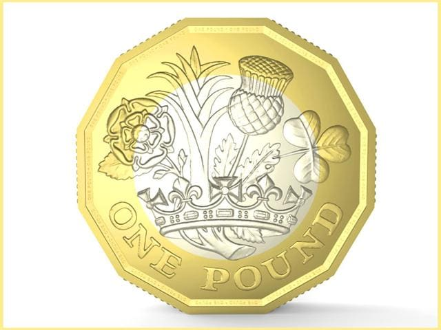 A-handout-image-received-from-Britain-s-Royal-Mint-on-March-18-shows-an-artists-impression-of-a-design-for-a-new-1-coin-AFP-Photo