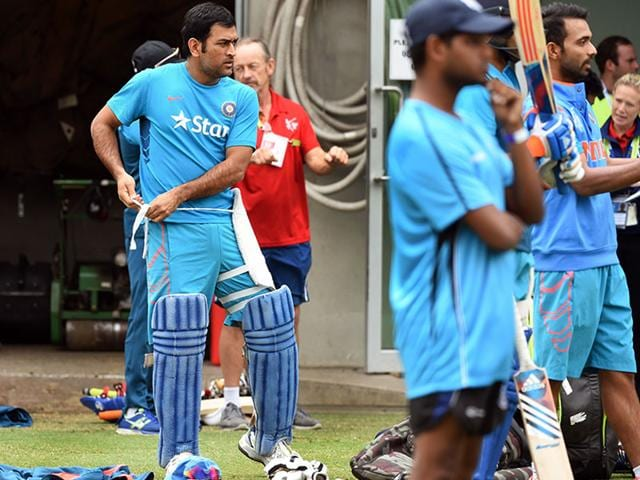 fb349aa0d Indian-captain-Mahendra-Singh-Dhoni-pads-up-during-a-training-session-ahead-of-their-2015-Cricket-World-Cup-quarter-final- match-against-Bangladesh-in- ...