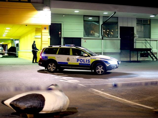 A-police-officer-examines-the-scene-of-a-fatal-shooting-in-Gothenburg-Sweden-AP-Photo
