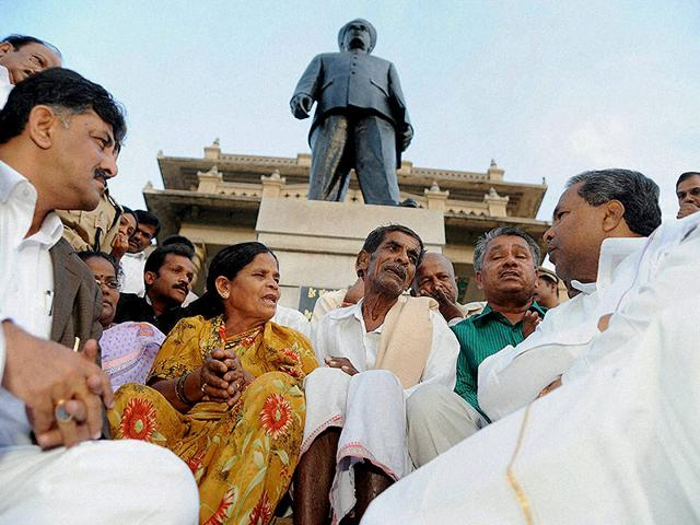Karnataka-chief-minister-Siddaramaiah-meets-parents-of-IAS-officer-DK-Ravi-at-Vidhan-Soudha-The-family-has-been-demanding-a-CBI-probe-into-the-death-of-2009-batch-officer-PTI-Photo