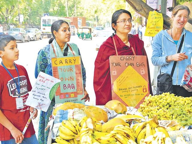 A-group-of-volunteers-from-Sarvodaya-Enclave-have-launched-a-silent-campaign-to-discourage-shopkeepers-as-well-as-consumers-from-using-plastic-bags-S-Burmaula-ht-photo