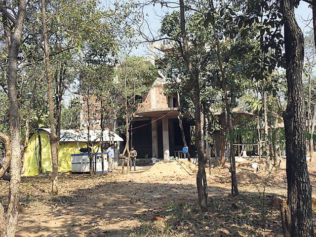 Work-on-the-under-construction-structure-at-Reni-Pani-village-that-serves-as-the-gateway-to-the-Satpura-national-park-has-been-stopped-following-the-forest-department-s-notice-HT-photo
